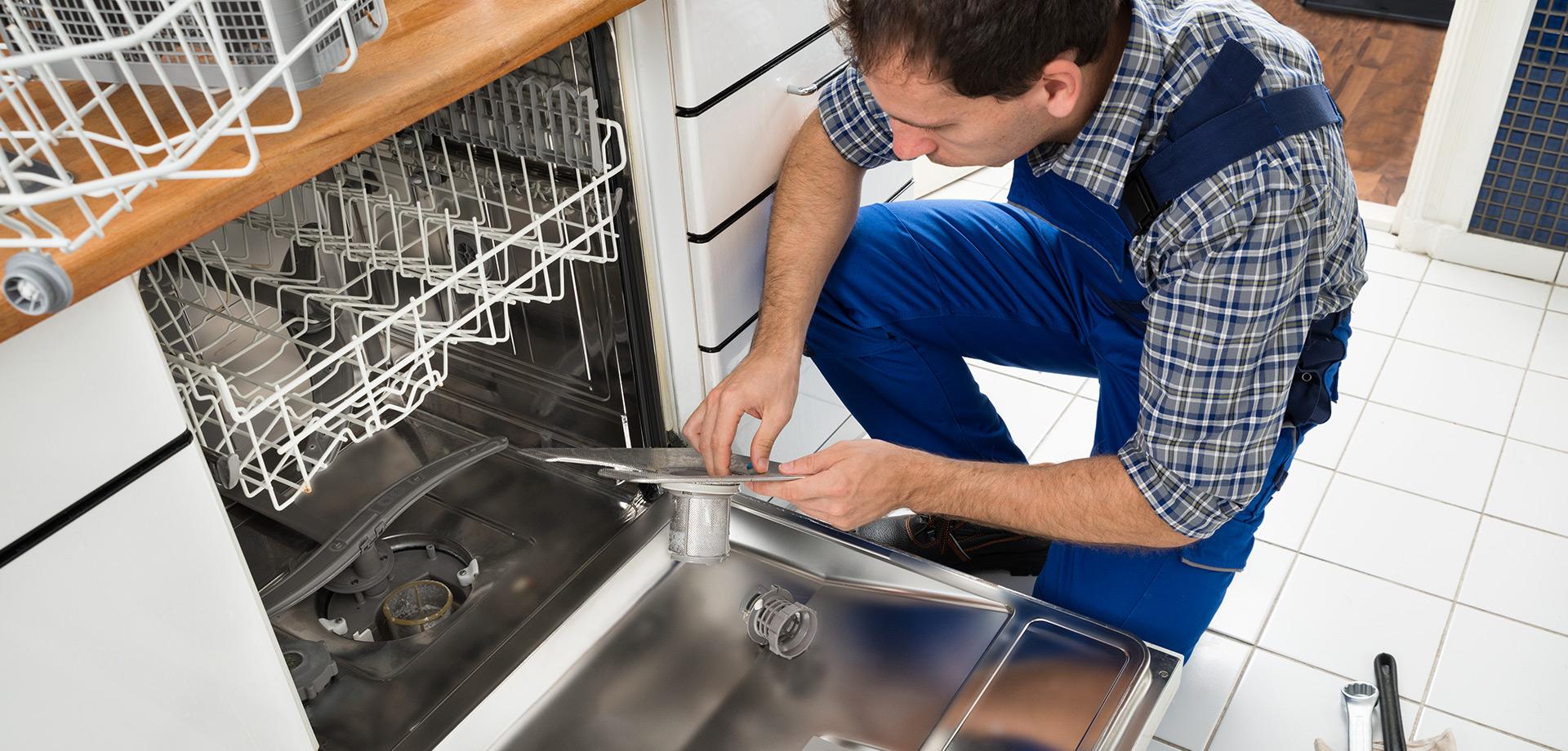 Technician fixing a dishwasher appliance part